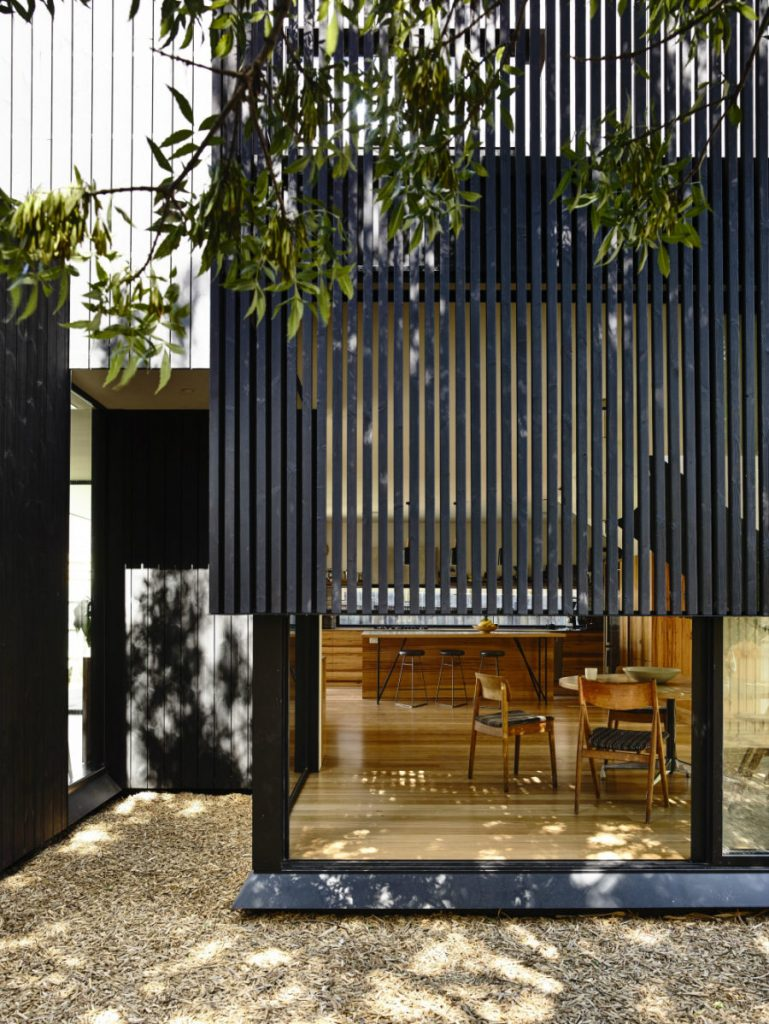 Houses-glass-features-get-light-and-privacy-from-wooden-screen-layer-900x1198