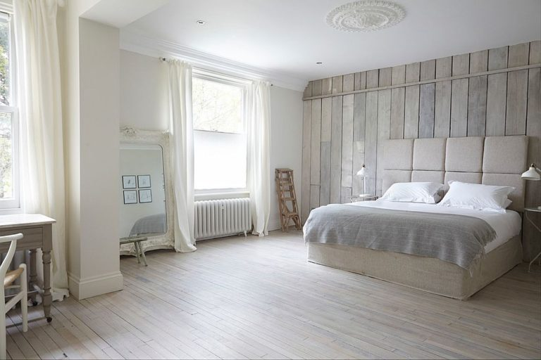 Tranquil-bedroom-in-white-uses-reclaimed-wood-all-around-768x512