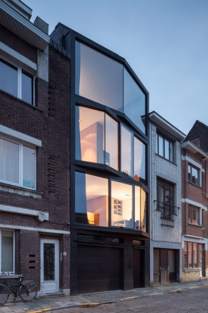 01-Abeel-House-was-built-on-a-narrow-plot-and-its-amazing-feature-is-angled-glazing-frames-775x1163