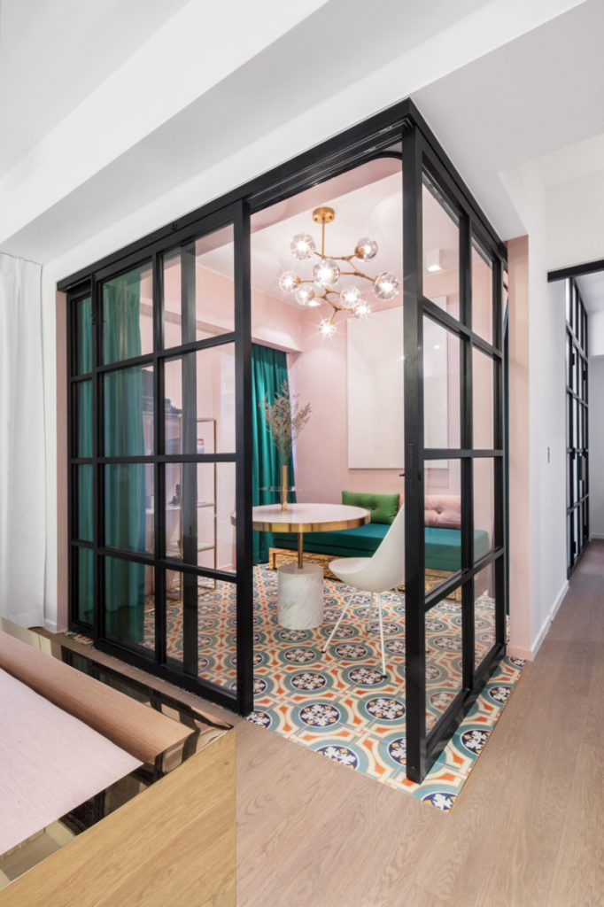 03-Suspended-metal-double-sliding-glass-doors-and-dark-jade-drapery-fully-transform-the-level-of-privacy-in-the-space-775x1163
