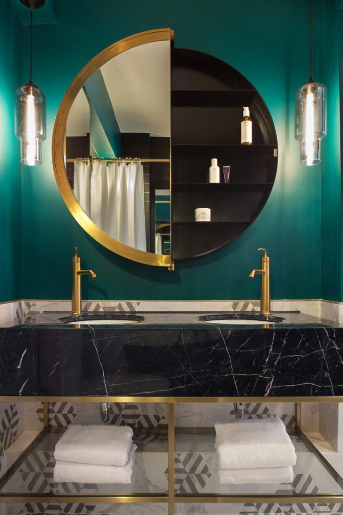 05-The-retail-inspired-walk-in-wardrobe-is-complete-with-custom-freestanding-polished-brass-closets-775x1163