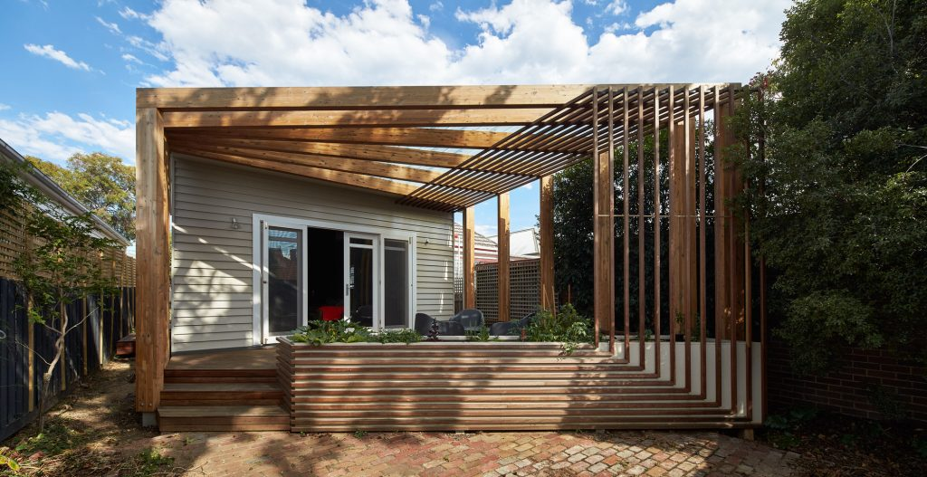 1-house-addition-triangular-deck-black-millwork