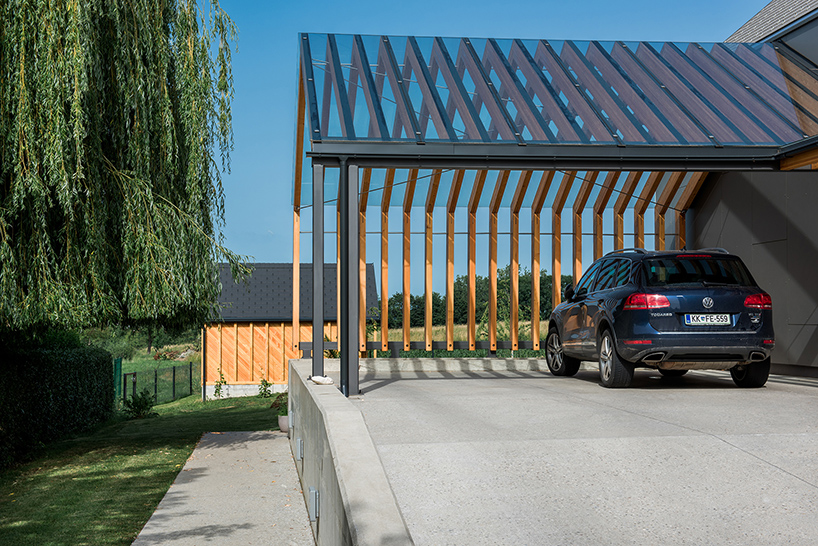 10-The-shortest-roof-is-extended-to-cover-the-carport-as-there-are-several-cars-and-one-garage-isnt-enough