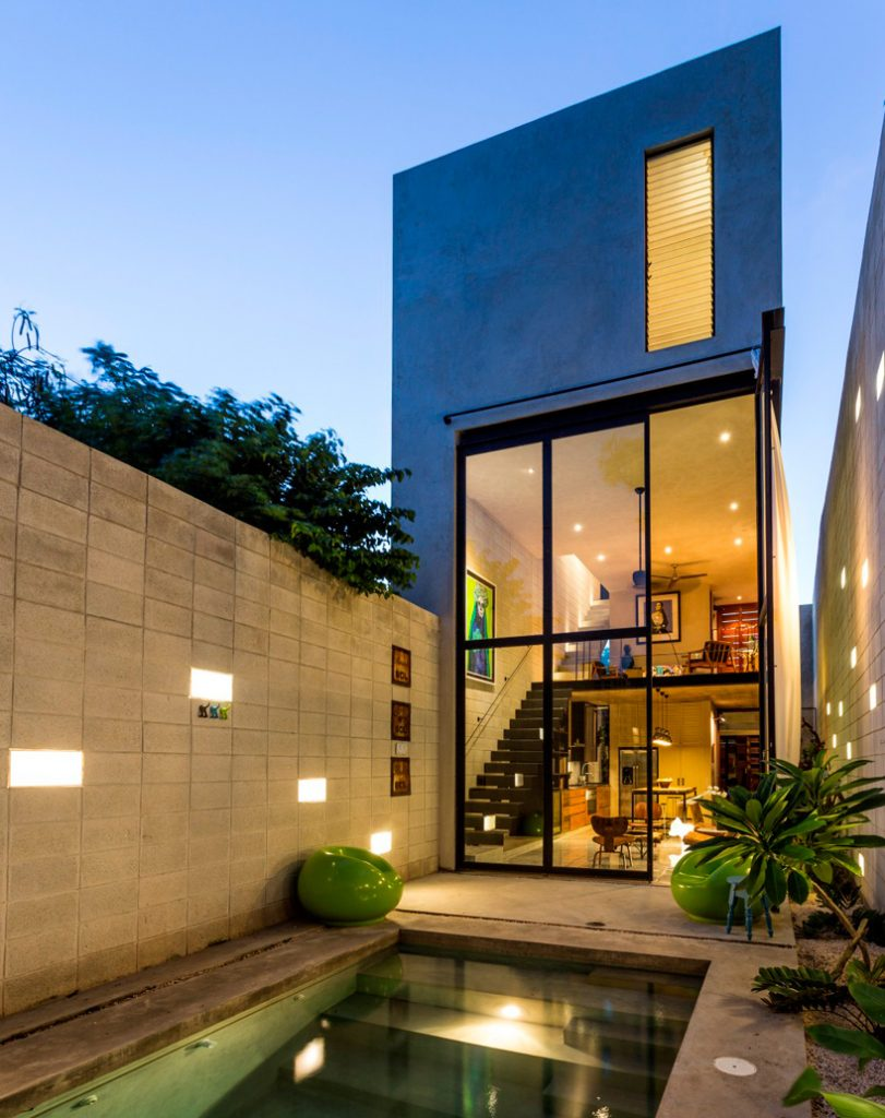 11-skinny-concrete-home-double-height-glass-doors
