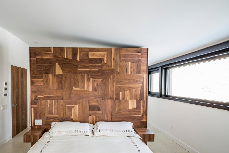 13-The-bedroom-can-also-boast-of-a-statement-wall-but-this-one-is-made-of-geometrically-clad-wood