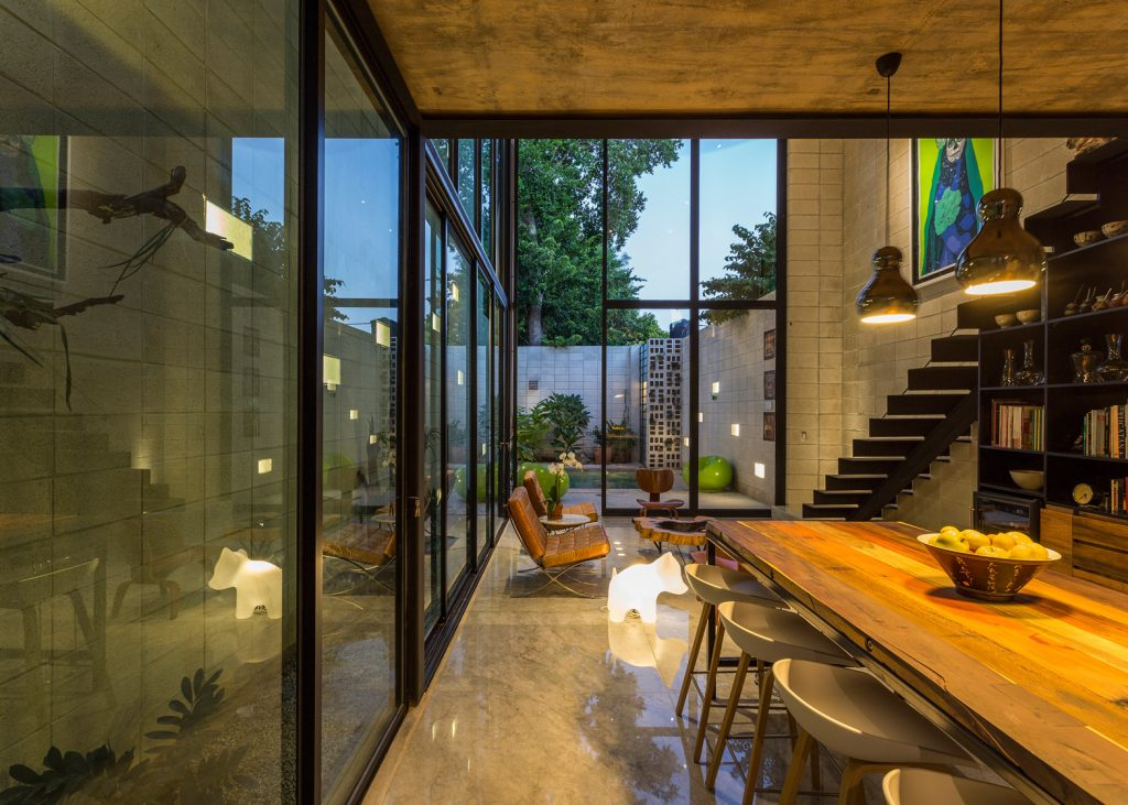 5-skinny-concrete-home-double-height-glass-doors