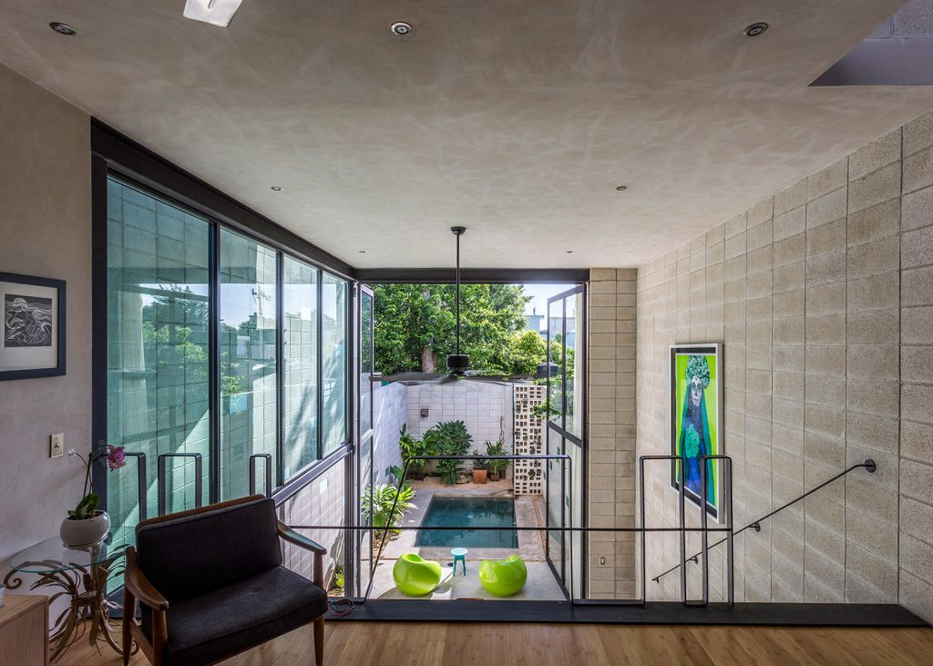 9-skinny-concrete-home-double-height-glass-doors