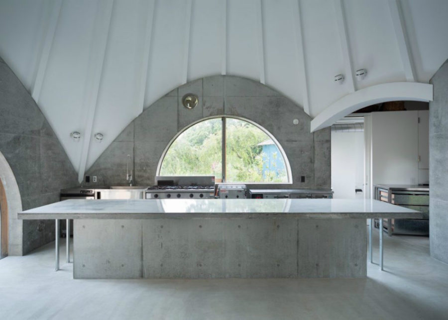 A-big-concrete-kitchen-island-is-a-work-space-for-one-of-the-residents-whos-cook-900x643