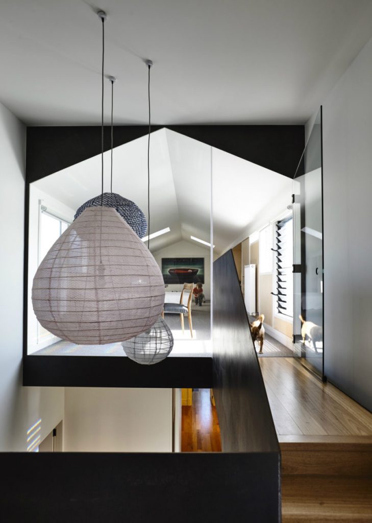 A-group-of-different-pendants-illuminated-and-decorate-the-staircase-900x1264