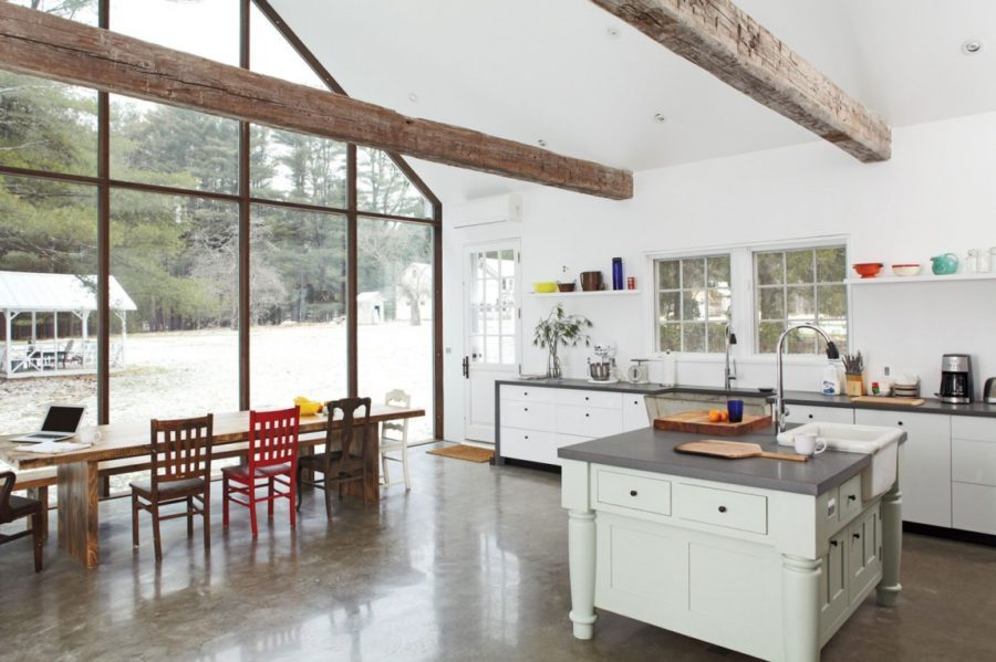 Concrete-floor-kitchen-design-with-wooden-beams-900x599