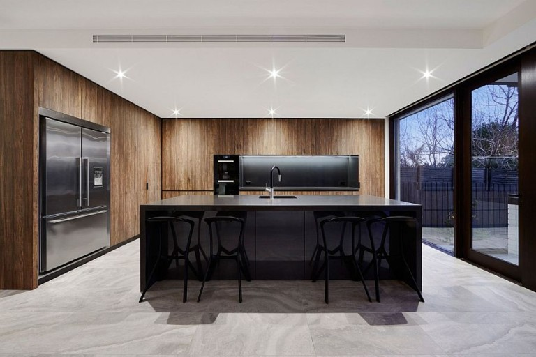 Dark-island-and-fascinating-wooden-shelves-shape-a-stunning-minimal-kitchen-768x512