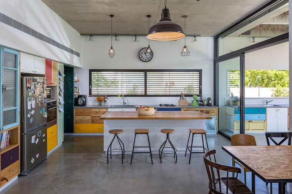 Exposed-concrete-floor-and-ceiling-of-the-breezy-family-home-in-Hofit-Israel