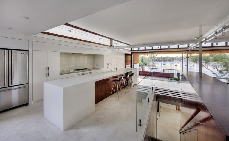 Gorgeous-modern-kitchen-with-large-island-in-white-768x474