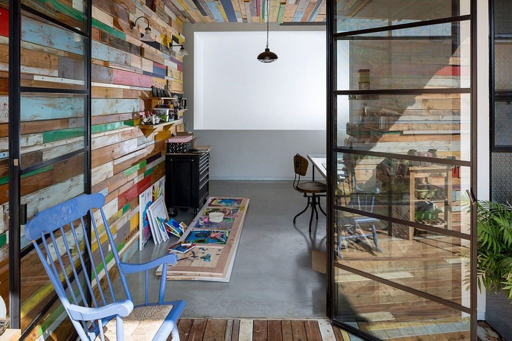 Home-studio-with-color-reclaimed-wood-wall