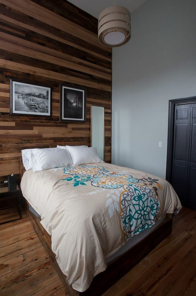 Wall-draped-in-reclaimed-wood-is-an-instant-showstopper-in-the-contemporary-bedroom-768x1155