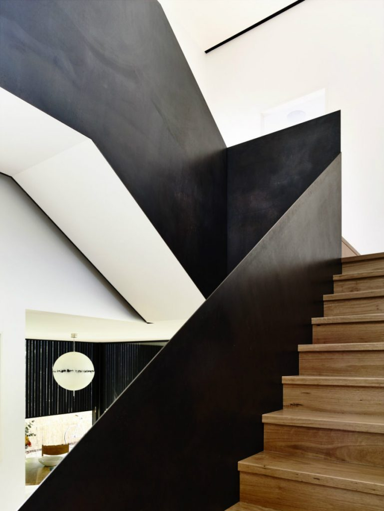 Wooden-staircase-comes-with-metal-railing-900x1198